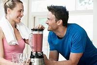 Couple making a post workout smoothie (thumbnail)