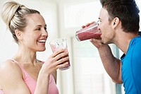 Couple drinking a post workout smoothie