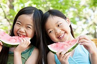 Little girls eating watermelon