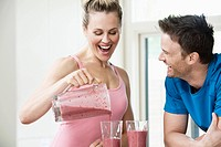 Couple having a post workout smoothie