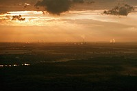 Sunset over industrial area