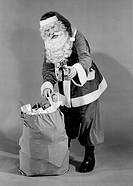 Father christmas pulling present from sack