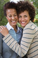 Mixed race mother and daughter hugging