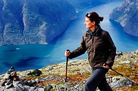 Young woman hiking with a view at the Aurlandsfjord, Prest, Aurland, Sogn og Fjordane, Norway, Scandinavia, Europe