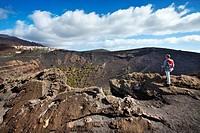 Hiker at volcano crater, Volcano San Antonio, Fuencaliente, La Palma, Canary Islands, Spain, Europe