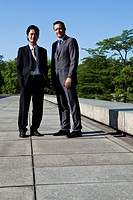 Two businessmen, outdoors, portrait