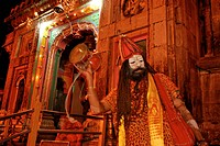 Holy Hindu temple dedicated to Shiva in Kedernath with Sadhu at evening ceremony, Uttarakhand, India, Asia