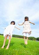 Sisters jumping