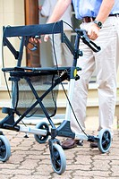Senior man walking with walking frame