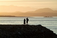 couple at sunset at Tofino, West Coast, Vancouver Island, British Columbia, Canada