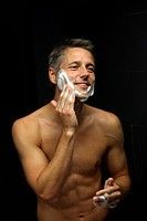Man applying shaving foam