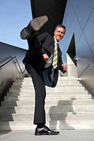 Businessman kicking with his foot
