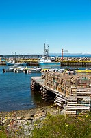 Lobster traps stacked on the wharf at Green Harbour, Newfoundland and Labrador, Canada.