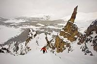 A backcountry skier hiking, Mount Assiniboine, Mount Assiniboine Provincial Park, British Columbia, Canada
