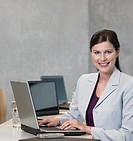 Portrait of businesswoman using laptop and smiling