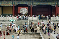Crowds of people visiting the Temple of Heaven pavilions as seen from across the courtyard, Beijing, China.
