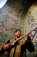 Central Asia, Uzbekistan, Samarcanda city,Sher Dor madrasa, musical instruments shop with guitar called tar