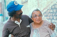 An African_American man hugs an elderly woman, Cairo, IL