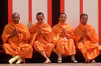 Four Buddhist monks meditating, Lotus Festival in Echo Park, Los Angeles, CA