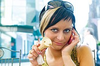 Attractive woman with icecream and cellphone