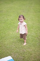 Girl walking on grass
