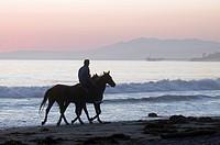 Horseback rider with horses on Rincon Beach Park.
