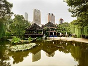 A tea house overlooking a calm lake in the Jing´an Park of Shanghai.