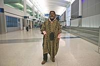 Traveler at an international airport, United States
