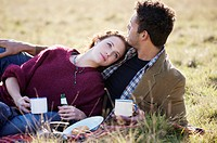 couple relaxing in field