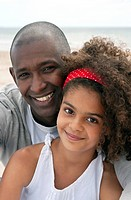 black father and daughter on the beach