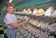 Woman holds shells at the Shell Factory, Fort Myers, Florida