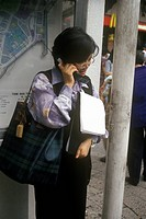 Woman on cellular phone in Hong Kong