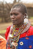 Masai female in robe with beads in village near Tsavo National Park, Kenya, Africa