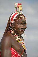 Portrait of Masai Warrior in traditional red toga and flowers on his head at Lewa Wildlife Conservancy in North Kenya, Africa