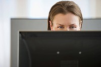 Eyes looking at computer monitor in office