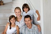 Portrait of a family in house