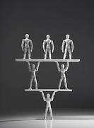 group of figures forming human pyramid
