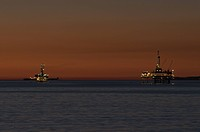 Ocean Oil Derricks at Dusk