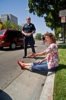 A woman argues with a Hispanic police officer after being stopped for a traffic violation in Santa Ana, CA