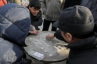 China, Beijing, xiangqi Chinese Chess players in a park
