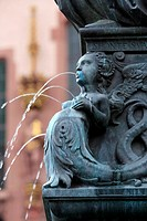 Detail at the base of the Lady Justice Statue, Römerberg, Frankfurt, Hessen, Germany  The base of the statue contains figures of mythical figures of ...