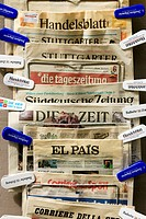 German, Italian and Spanish newspapers on sale outside a paper shop in Freiburg im Breisgau, Germany