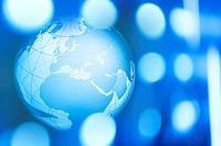 Earth globe against blue