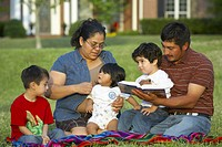 Hispanic family outside having picnic