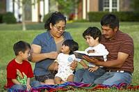 Hispanic family outside having picnic