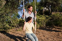 Mid adult couple on a swing