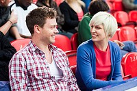Man and woman at football match