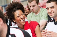 Happy woman at football match (thumbnail)