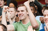 Man cheering at football match