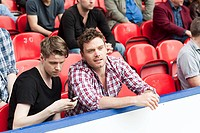 Young men at football match